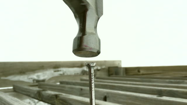 Slow motion hammer pounding nail, camera attached to hammer-handle. video