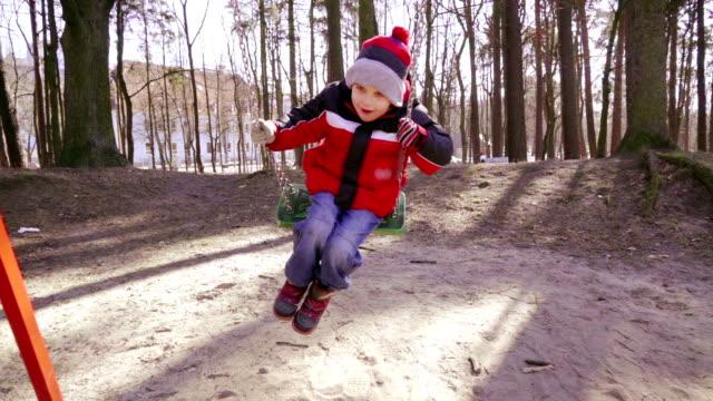 Slow motion: Happy Kid on Swing video