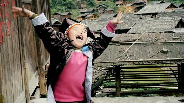 stockvideo's en b-roll-footage met slow motion happy village boy cheering up - oost aziatische cultuur