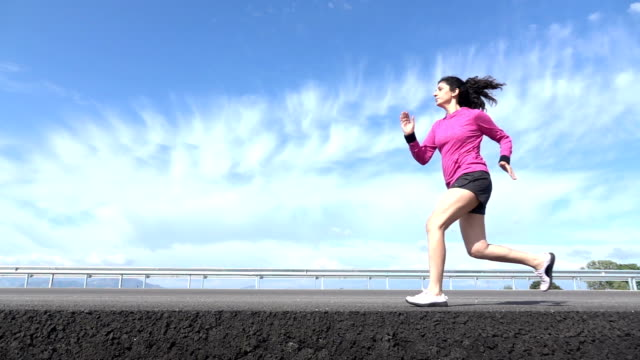 Slow Motion HD Video Of Adult Woman Running On Asphalt Road video