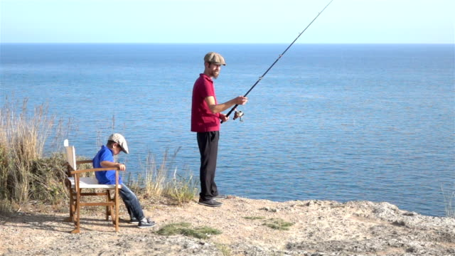 Slow Motion HD Video Of Father And Son Fishing video