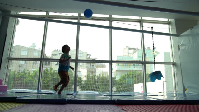 Slow Motion HD Video Of Little Boy Playing With Balloon Indoor video
