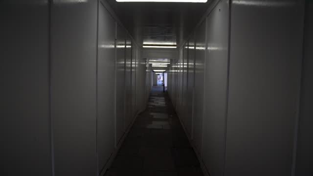 Slow Motion HD Video Of Walking In A Dark Tunnel video
