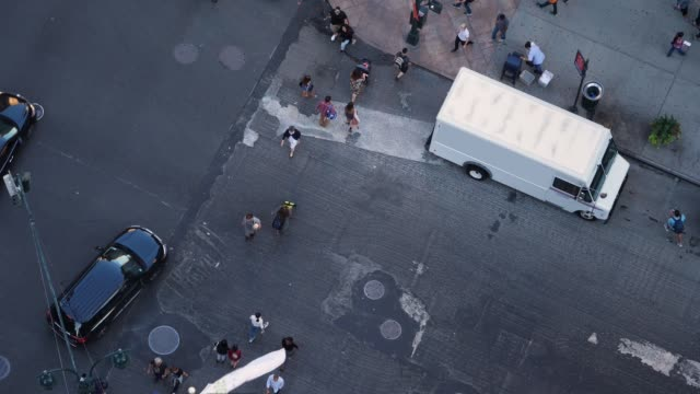 Slow Motion High Angle View of Traffic and Pedestrians on 5th Avenue in Manhattan video