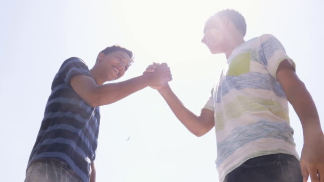 Slow Motion Hispanic And White Teenagers Shaking Hands video