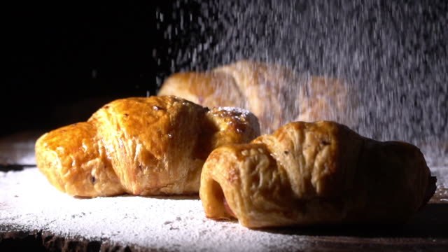 Slow motion icing is falling to bread
