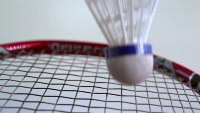 Slow motion impact of shuttlecock on badminton racket Badminton clean background shot in slow motion with racket and shuttlecock competition group stock videos & royalty-free footage