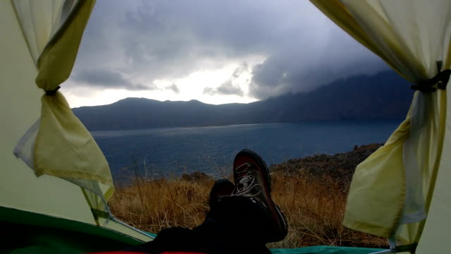 Slow Motion in a tent near the Nemrut Crater Lake with wind, clouds and rain video