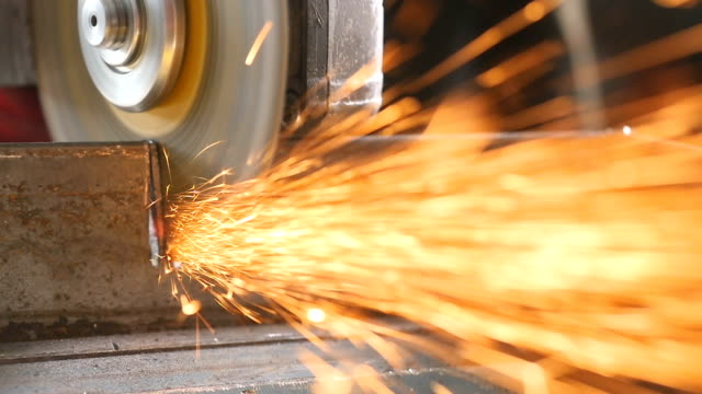 slow motion: industrial grinder in action. a lot of sparks. - rettificatrice video stock e b–roll
