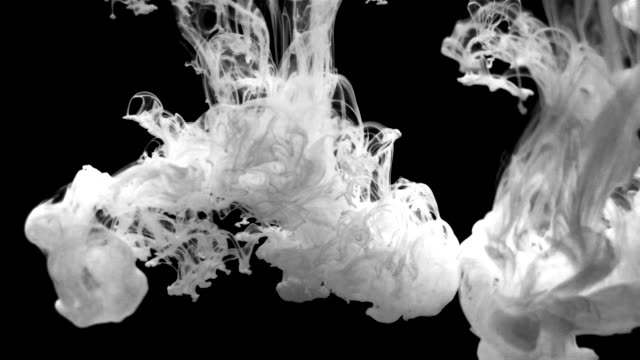 Slow motion Ink drops expands and swirls in water beautiful background