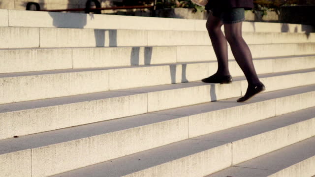 Slow motion: Lady legs on a stairs video