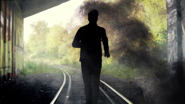 slow motion. lost man running to the unknown. back view. abstract silhouette shot. rushing to escape imminent danger - opportunity stock videos & royalty-free footage