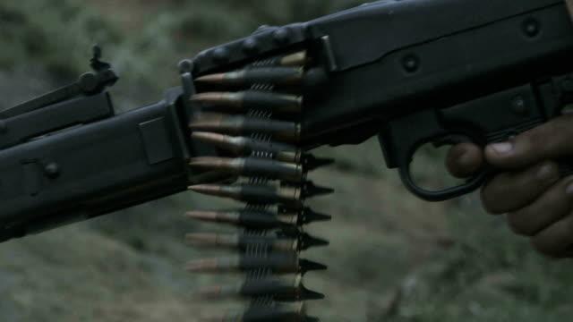 slow motion machine gun fire video