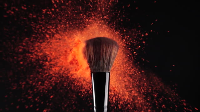 slow motion: makeup brush and red powder exploding - макияж стоковые видео и кадры b-roll