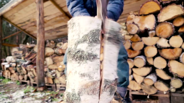 Slow motion: Man chopping wood video