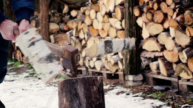 Slow motion: Man chopping wood video