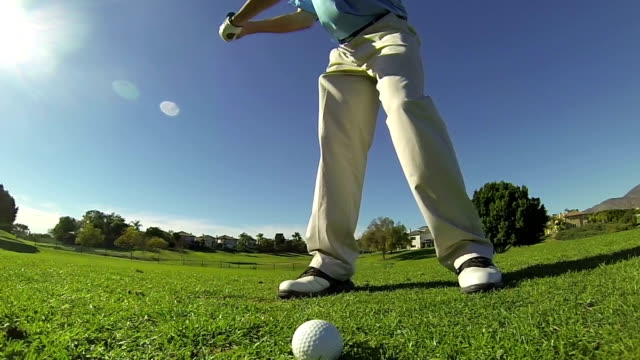 Slow Motion - Man Hitting Chip Shot At Golf Course video