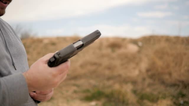 Slow Motion Man Loads Magazine Into Handgun video