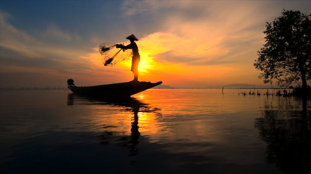 Slow motion movie of Fisherman Throwing net, Sunrise Scene, Thailand