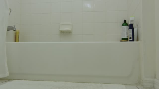 Slow motion moving away from a bathtub video