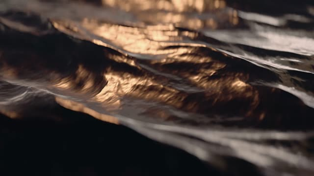 Zeitlupen-Ozeanwellen bei Sonnenuntergang aus nächster Nähe. schlinge. 3D-Animation. – Video