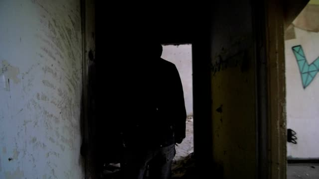 Slow motion of a drunken bum walking in an abandoned house video