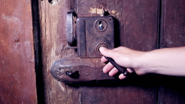 Slow motion of a hand opening an ancient wooden door Slow motion of a hand opening an ancient wooden door ancient architecture stock videos & royalty-free footage