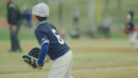 Slow motion of a kid running during a baseball game Daytime slow motion shot of a kid in the field running during a baseball game childhood stock videos & royalty-free footage
