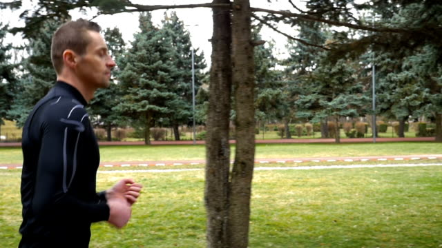 Slow motion of athletic man running in the park video