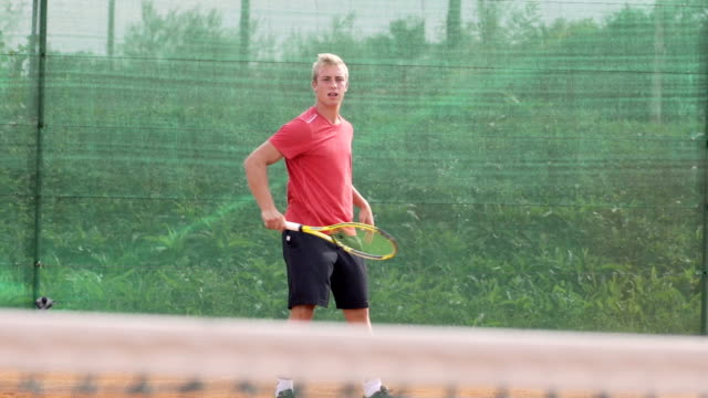 Slow Motion Of Athletic Tennis Player On Clay Court video