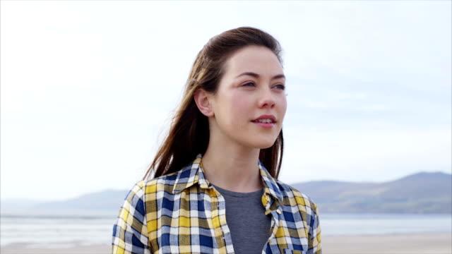 Slow motion of beautiful woman enjoying nature on beach video