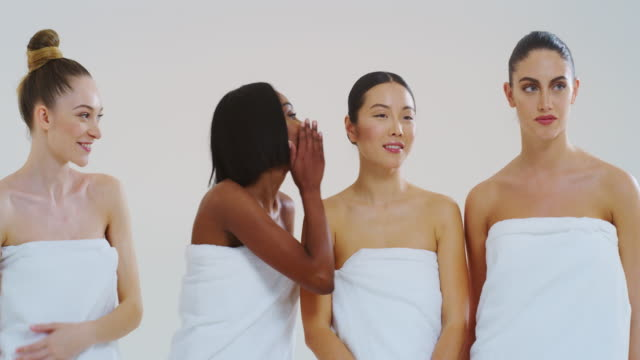 Slow motion of beautiful young smiling women of different ethnicities with perfect firm and slim body in white bathing towels dancing and having fun isolated on white background Slow motion of beautiful young smiling women of different ethnicities with perfect firm and slim body in white bathing towels dancing and having fun isolated on white background. serum sample stock videos & royalty-free footage