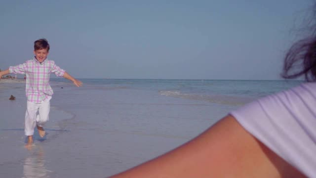 Slow Motion of Boy Running into Mothers Arms at Beach video