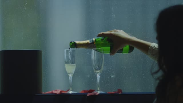 Slow motion of bride pouring champagne in two glasses video