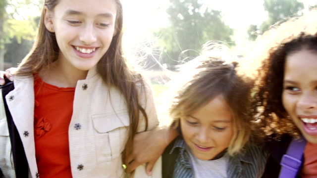 Slow Motion Of Children Hanging Out In Park Together video
