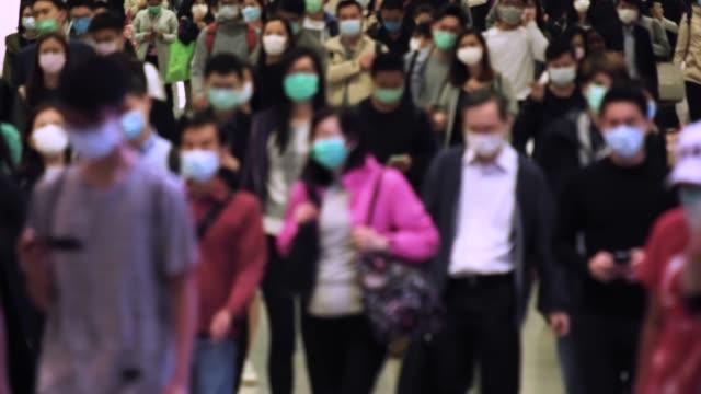slow motion of crowd people wearing medical face masks at metro in hong kong. coronavirus concept - zagadnienia filmów i materiałów b-roll