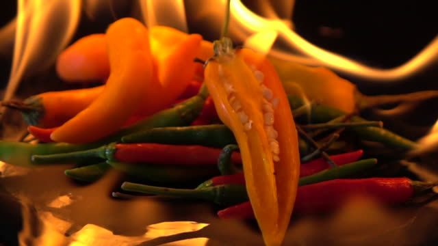slow motion of fire burning chili on black background - thai food stock videos and b-roll footage