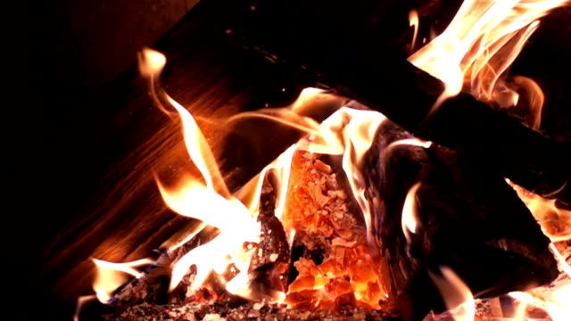 Slow motion of fire flames burning log Slow motion of fire flames burning log firewood stock videos & royalty-free footage