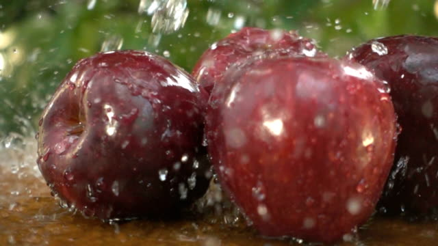 Slow motion of Fresh apples with water splash video
