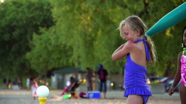Slow Motion of Girl playing baseball at beach video
