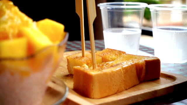 Slow motion of grab toast from wooden dish video