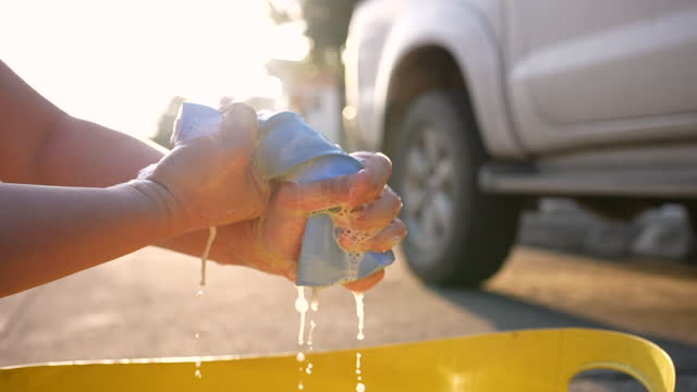 Slow motion of Hands , Car towel with Car wash liquid for washing a car