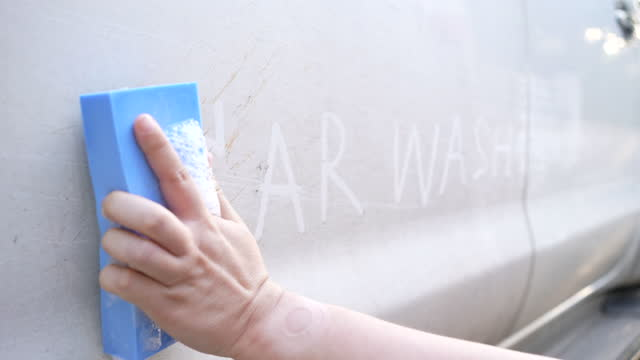 Slow motion of Hands washing a car , Car towel