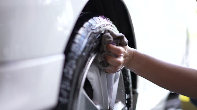 Slow motion of Hands washing a car