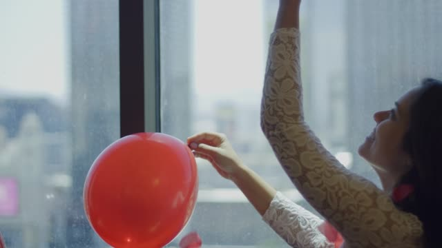 Slow motion of happy bride with balloon throwing rose petals to air video