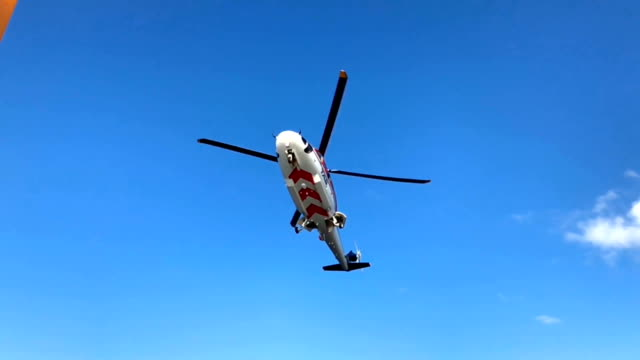 slow motion of helicopter landing on oil and gas platform helideck to transfer crews or passenger to work in offshore oil and gas industry, air transportation for support passenger. - helikopter filmów i materiałów b-roll