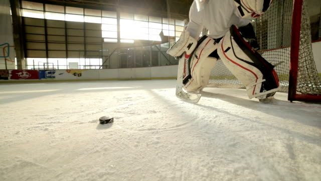 Slow motion of ice hockey goalie trying to defend his goal on a match during the game. video