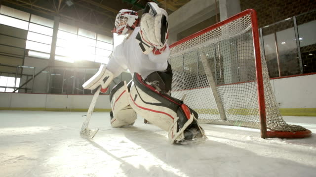 slow motion of ice hockey goaltender failing to defend the goal in a rink. - praticare video stock e b–roll