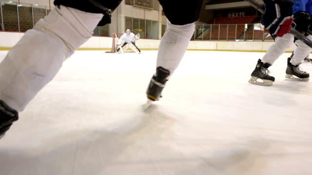 slow motion of ice hockey players in action during a match in ice hockey rink. - hockey stock videos and b-roll footage