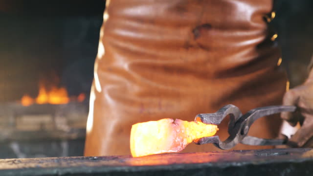 Slow motion of incandescent metal getting hammered. Slow motion. Slow motion of incandescent metal getting hammered. HD anvil stock videos & royalty-free footage